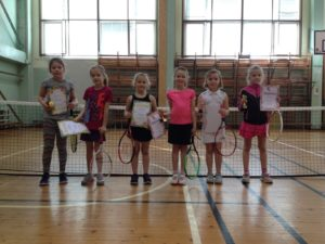 Young tennis players compete at winter season